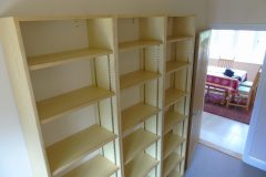Ash bookcases with adjustable shelving