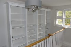 White painted wooden bespoke bookshelves