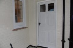 Bespoke hardwood front door. Primed ready for painting.