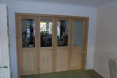Bifold room dividing doors
