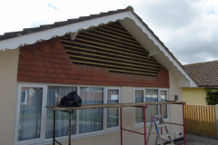 Tiles replaced with cedar cladding